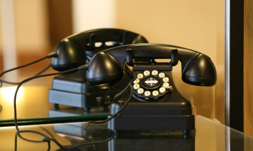 rotary telephone in front of a mirror