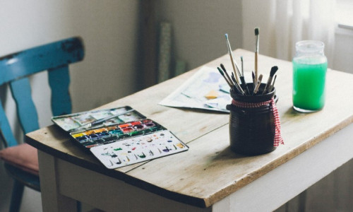 paints and brushes on a table