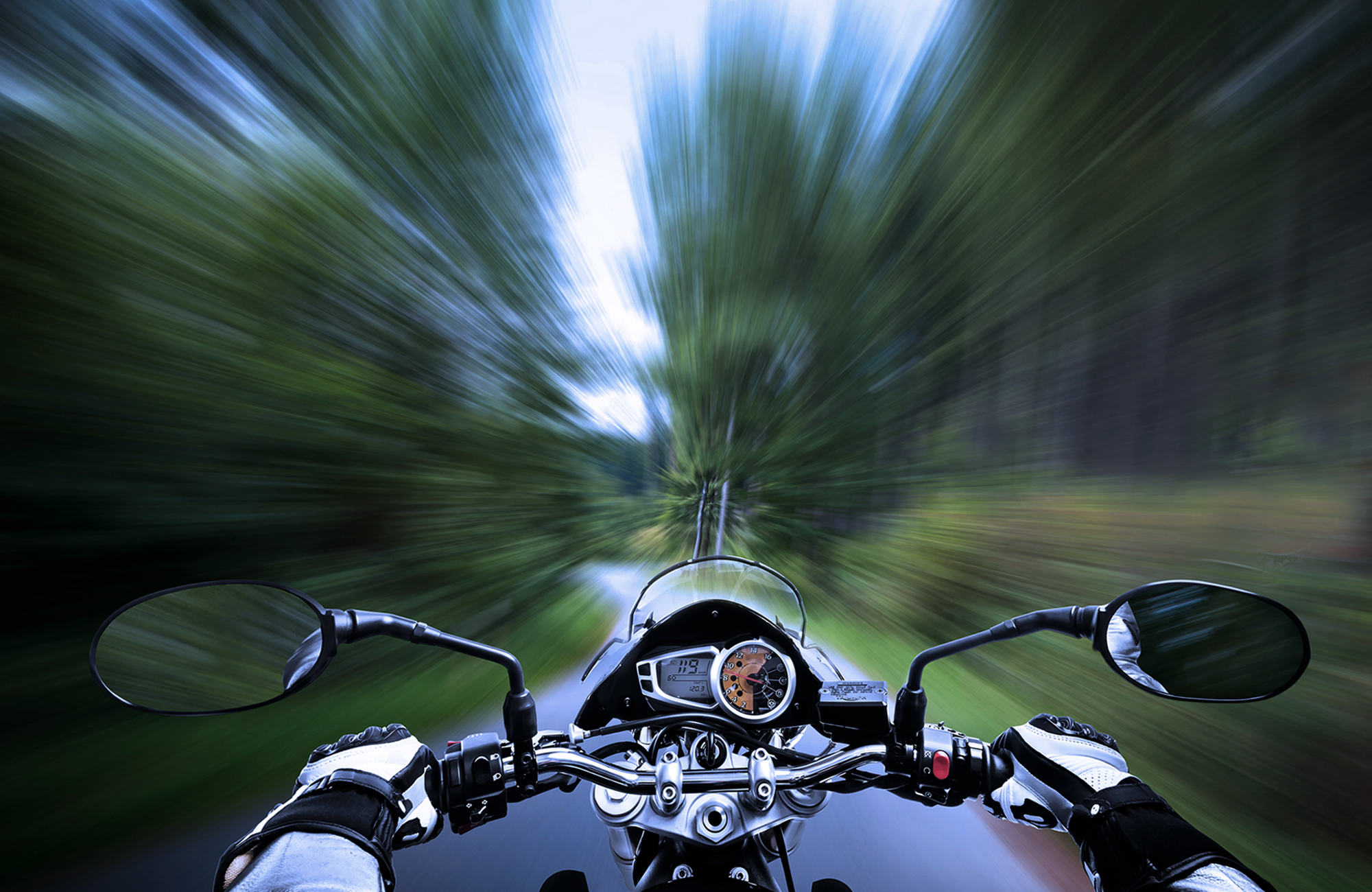 motorcycle speeding, blurred background