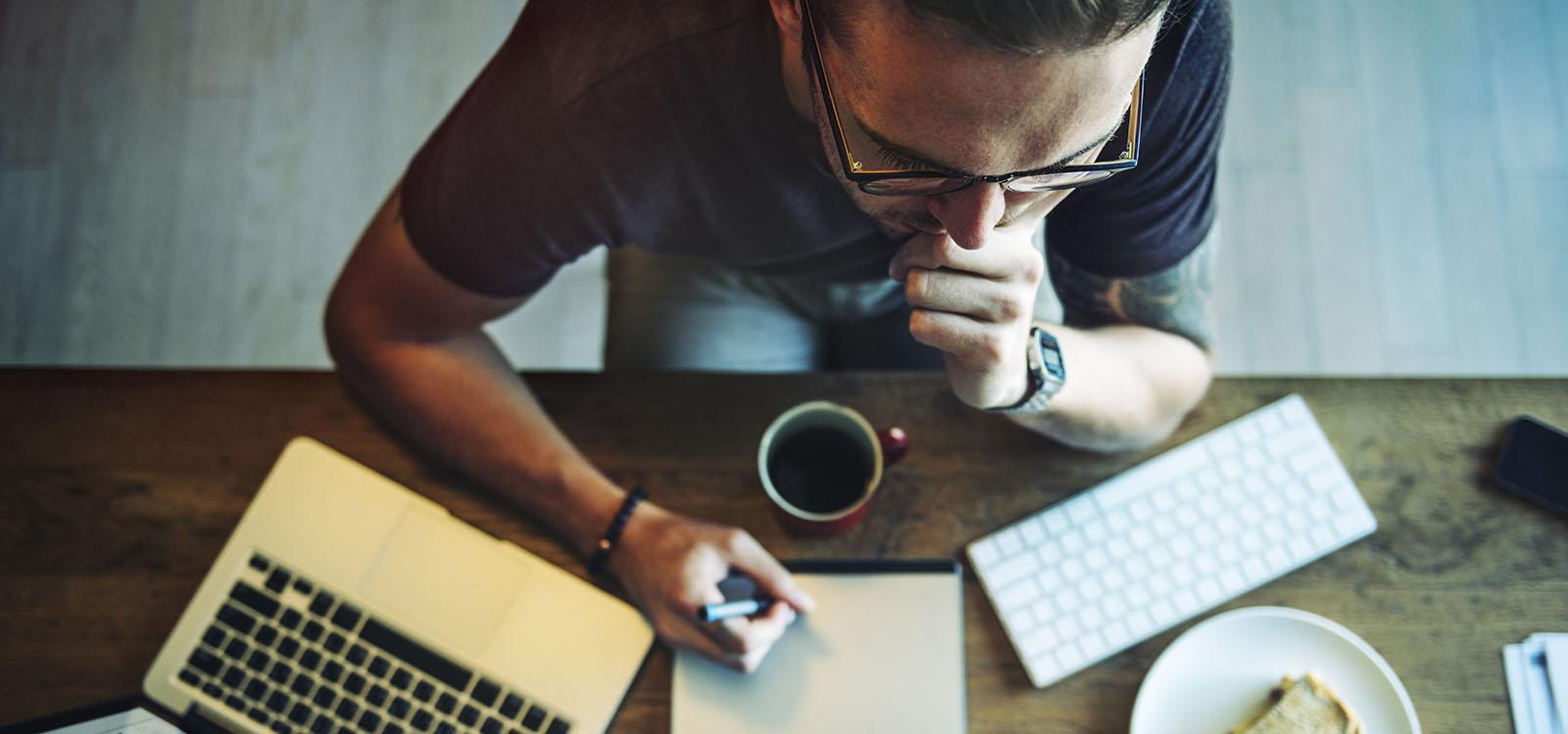 man concentrating at computer